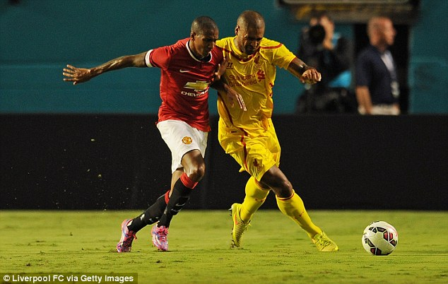 Expected: Jones' team-mate Ashley Young (left) tweeted that is was 'no shock' the defender had no cash