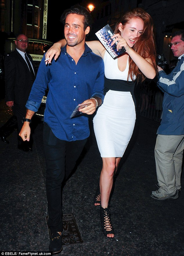 Party people: Spencer Matthews looks jovial as he makes his way into the exclusive nightclub
