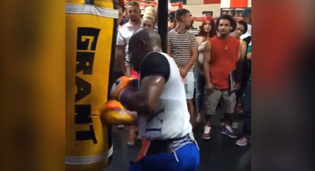 Moneymaker: Flloyd Mayweather shows off his skills to fans who crowded round to catch a glimpse