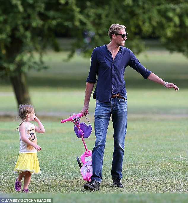 Scooter fun: Later that day, Peter Crouch took their daughter Sophia for a trip to the park