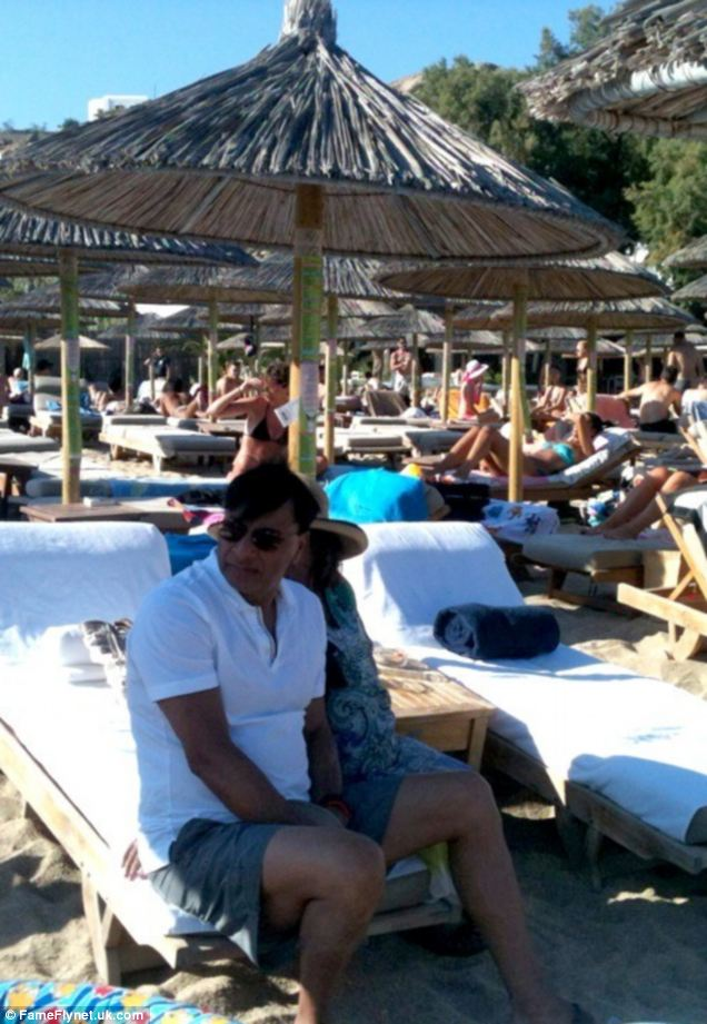 In his white T-shirt and black shorts, Indian billionaire Lakshmi Mittal looks like any other holidaymaker