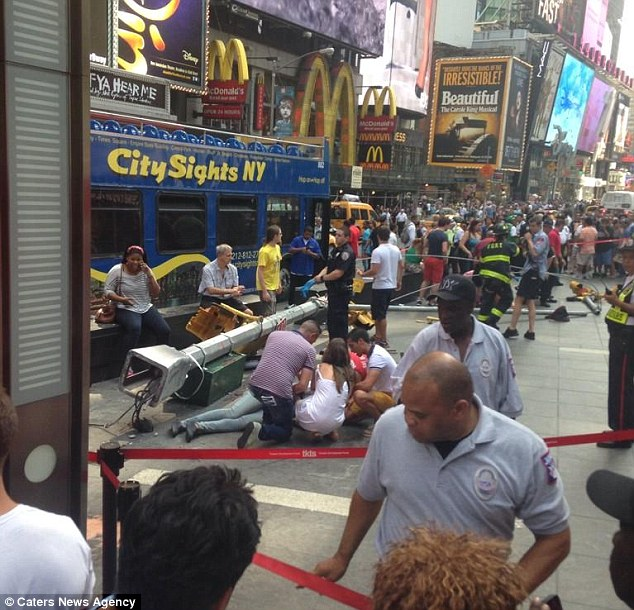 A traffic accident involving two double-decker tour buses in the city's Theater District on Tuesday afternoon sent shattered glass flying and injured 13 people, three of them seriously