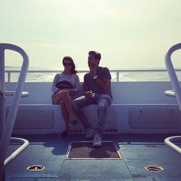 In the moment: Kourtney shared a reflecting picture of her and partner Scott Disick during the boat ride