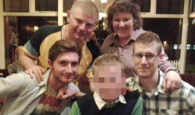 Jonathan and Derisa Trenchard with three sons Joshua (left), Christopher (right) and schoolboy Joel (centre)