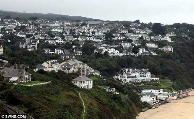 Picturesque: Carbis Bay, near St Ives in Cornwall, where Jonathan and Derisa Trenchard lived