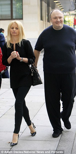 Living in fear: Mr Gorbuntsov came out of hiding to attend court today accompanied by his partner, Natalia Semchenkova, pictured left, and bodyguards