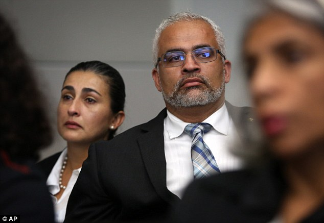 Parents: Carlos and Claudia Aguilar listen as the prosecution gives opening statements on Tuesday