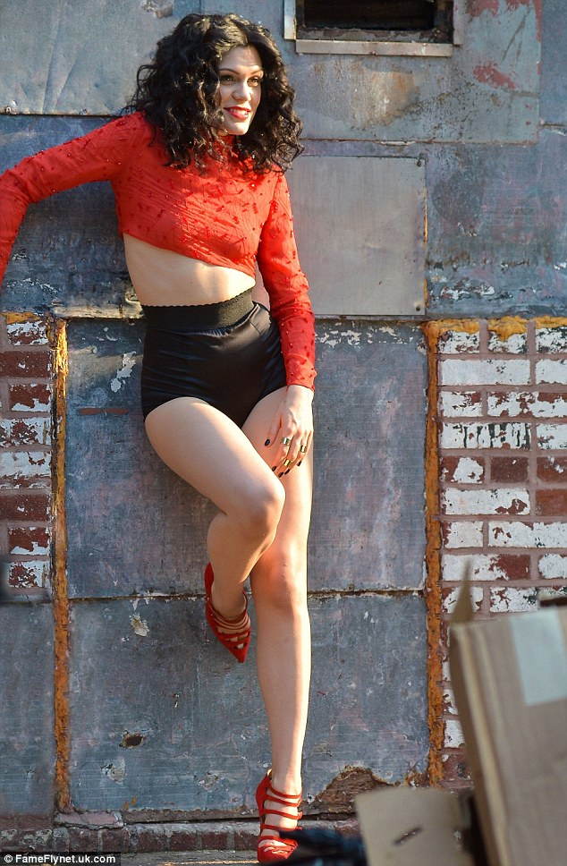 That's a mature look! Jessie J strips down to a red crop top and granny pants on the set of her new music video Bang Bang in New York on Tuesday