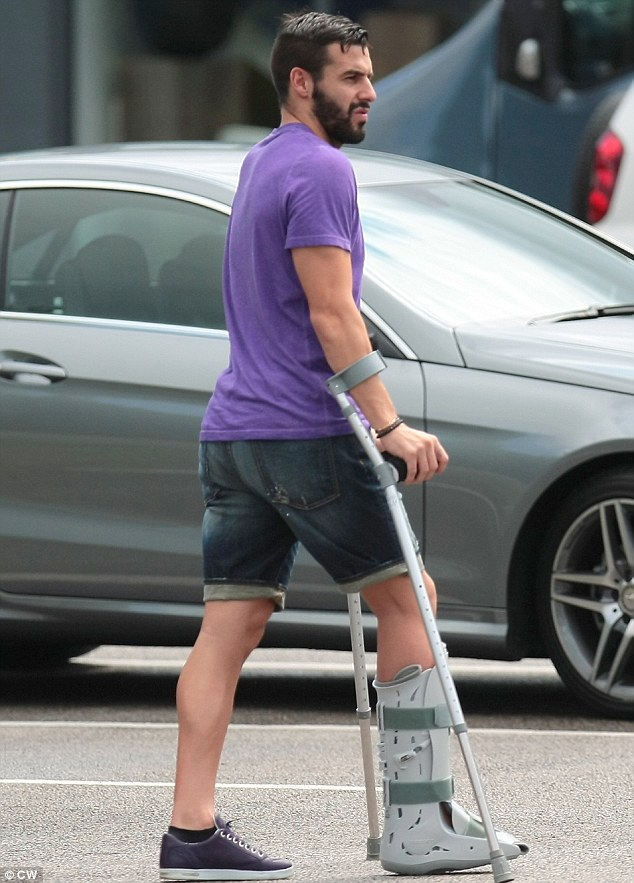 Walk of pain: City's Spanish striker is currently out injured after fracturing his metatarsal