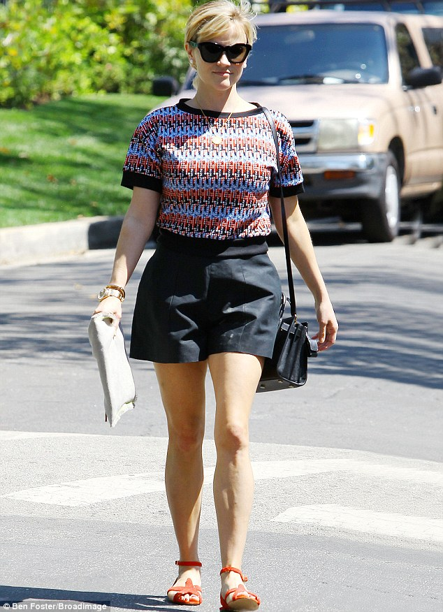 Soaking up the sun: Reese dons a casual chic ensemble while out and about in Brentwood on Wednesday