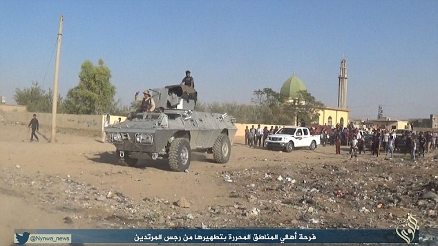 Marauding: ISIS has posted pictures of its takeover of Sinjar on social networking sites
