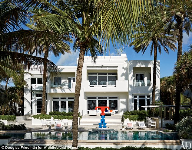The house that fashion built! The exterior of the couple's home shows a sculpture overlooking a beautiful pool