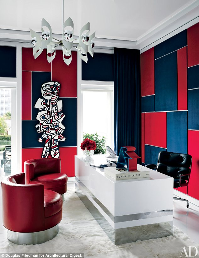 This would make going to work a lot more fun! Mr Hilfiger's home office has color-blocked faux suede walls and artwork by Jean Dubuffet
