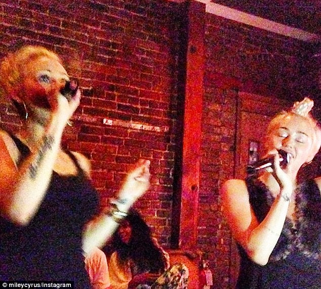 Mother daughter duo: Miley was joined her mum Tish Cyrus as they belted out karaoke hits