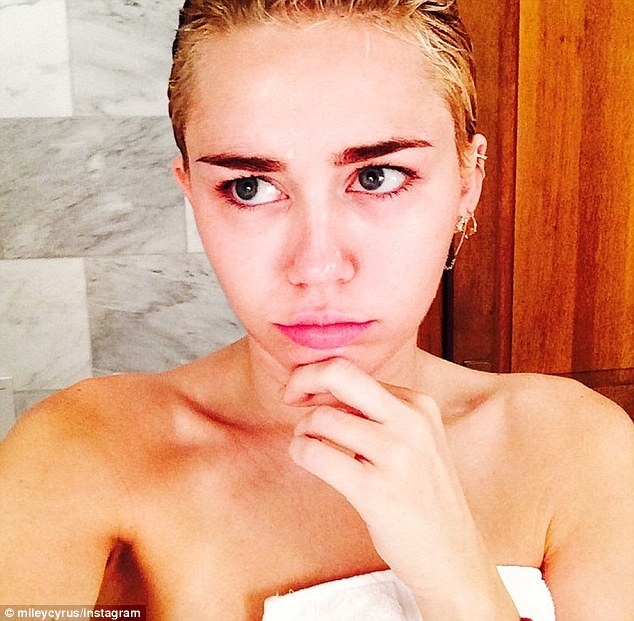 Suffering: Miley shared this shot the morning after and hashtagged that she had too much soju vodka