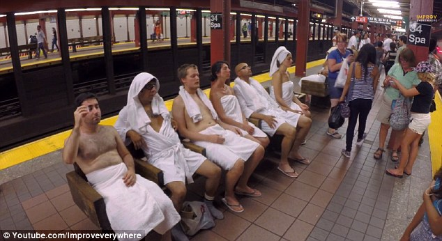 Sweatin' it out! Actors as part of the 'Subway Spa' prank by Improv Everywhere wore towels on the 'sauna seats'