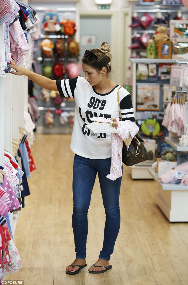 Treats: Sam Faiers shops for baby clothes for her little niece in Essex