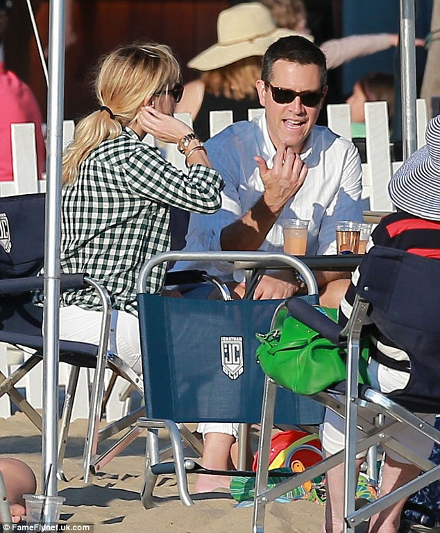 Family time: The couple sit with Reese's 10-year-old son Deacon as they chat and soak up the sun