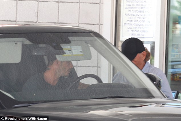 Petrol head: The sports icon stopped for petrol in his brand new Range Rover