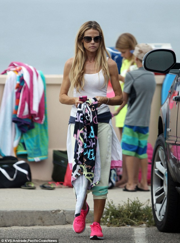 Domestic goddess: The actress looked like a model mum as she collected her children from the beach in her most comfortable gym kit