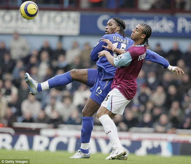 Experience: Ferdinand battles for the ball with Chelsea's Didier Drogba during his time at West Ham