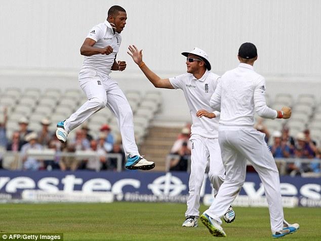 Flying high: Chris Jordan jumps for joy after taking the wicket of Ajinkya Rahane at Old Trafford
