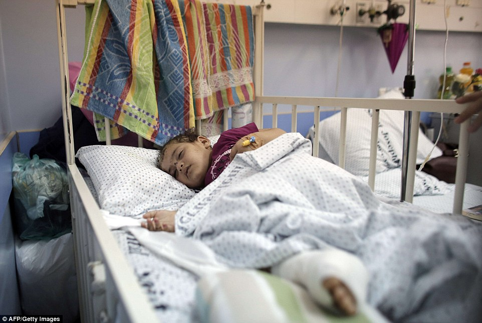 Hanan Abu Leil, a six-year-old Palestinian girl injured by an Israeli airstrike, recovering in the Makassed hospital in East Jerusalem. Doctors and aid agencies are trying to capitalise on a truce in Gaza to evacuate more wounded Palestinians for life-saving medical treatment in east Jerusalem, Israel and Jordan