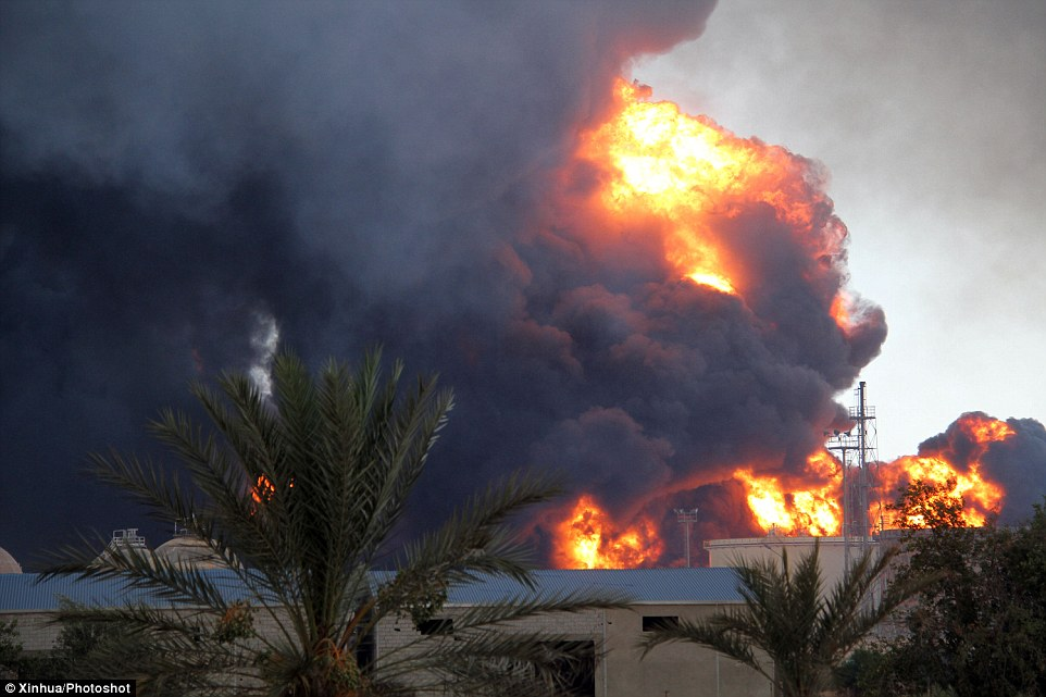 Inferno: A closer view of the fuel depot shows flames licking upward as thousands of tons of oil burn
