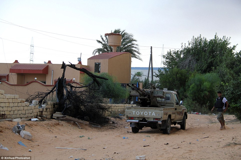Country in the grip of extremists: An Islamic militiaman is seen during a clash near Tripoli International Airport