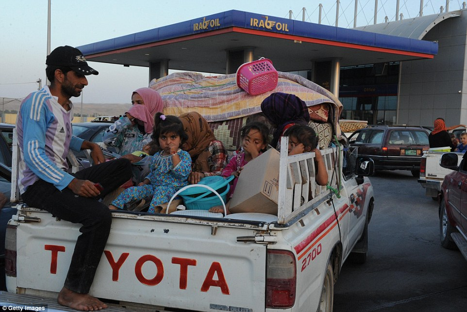 Thousands of Yazidi and Christian people flee Hamdaniyah town of Mosul to Erbil yesterday after the latest wave of Islamic State advances that began on Sunday
