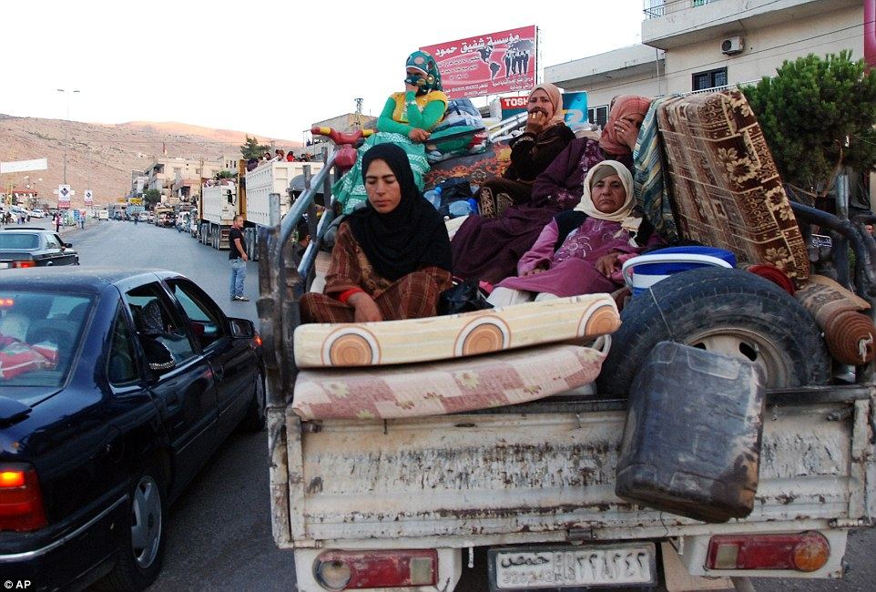 More Syrian refugees stream towards the border back to their home country: Islamic State militants tried to seize control of a Lebanese town this week