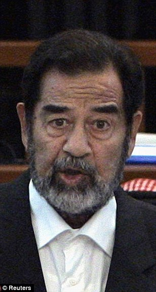 Saddam Hussein speaks to the court during the continuation of his Anfal genocide trial in Baghdad November 28, 2006.