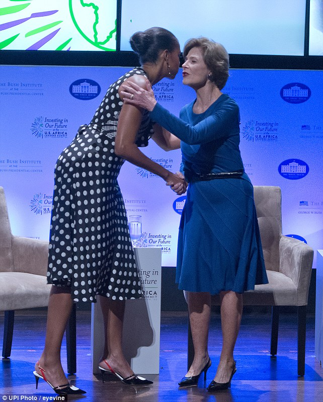 First lady Michelle Obama and former first lady Laura Bush held a conversation on the need to invest in the futures of young girls and women at the U.S. - Africa Leaders Summit yesterday in Washington, D.C.