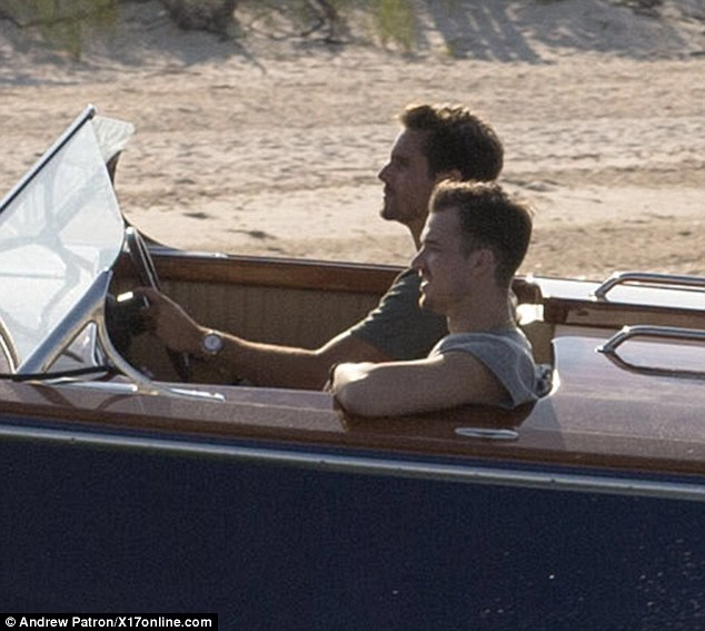 The captain: The father of Mason and Penelope was at the wheel of the boat as he was joined by a male companion