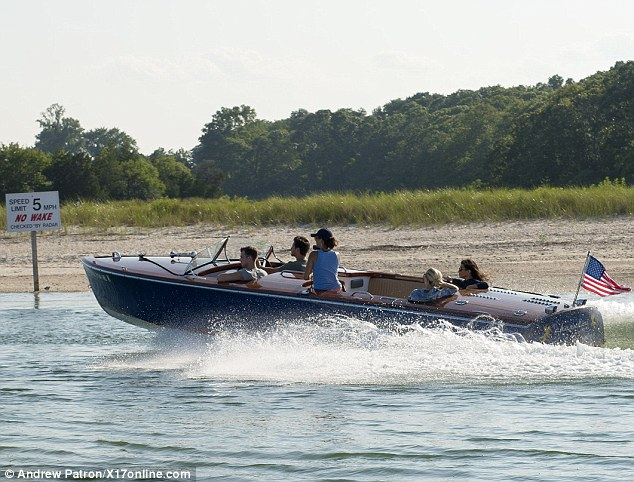 Speed demon: Scott and his  Kourtney Kardashian were spotted with two friends riding a speed boat earlier in the day