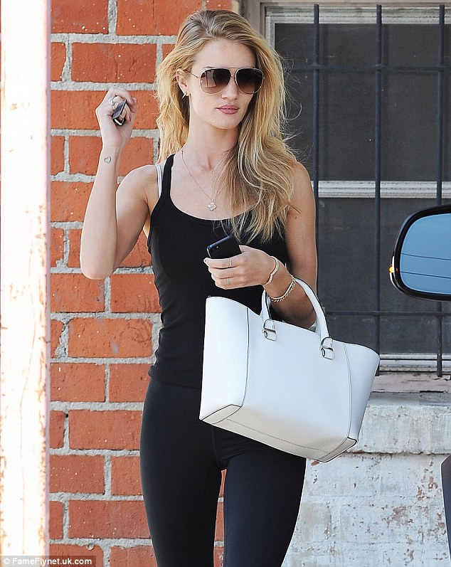 Working up a sweat! Model and actress Rosie Huntington-Whiteley is seen leaving the gym after a workout in West Hollywood, California on Wednesday