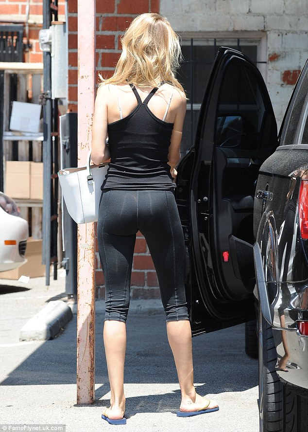 Off she goes! The 27-year-old model shows off her slender figure as she climbs into her car