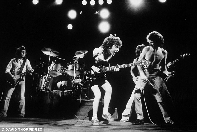 Guitarist Malcolm Young on stage with AC/DC in 1971