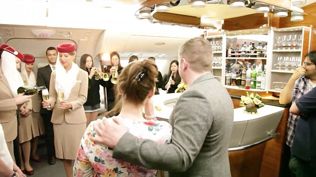 She said yes! The happy couple celebrate their fragment on the Emirates A380 flight