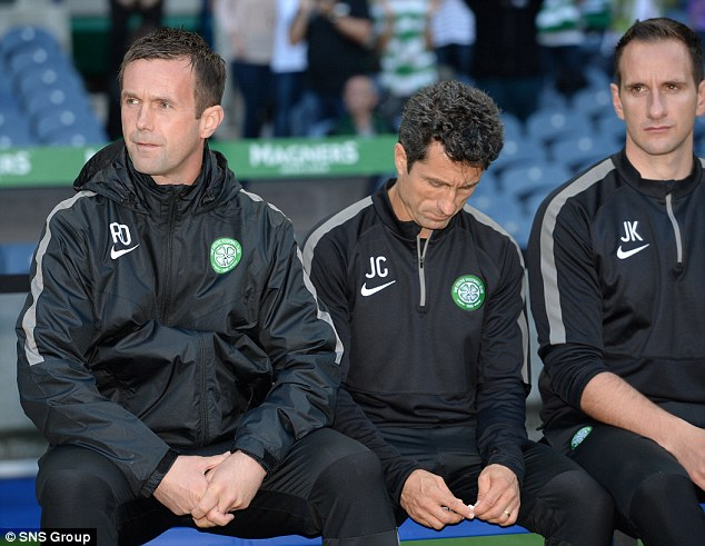 Heat is on: Deila (left) sitting beside assistants John Collins and John Kennedy has suffered an horrendous start as Celtic boss following the Hoops failure to reach the group stage