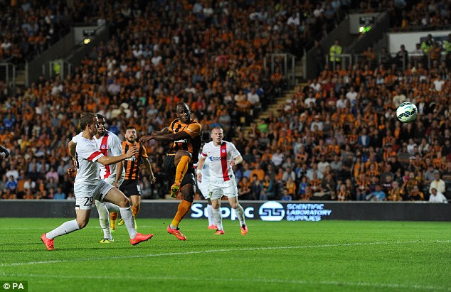 Match winner: Sone Aluko scores his side's second goal during UEFA Europa League qualifying