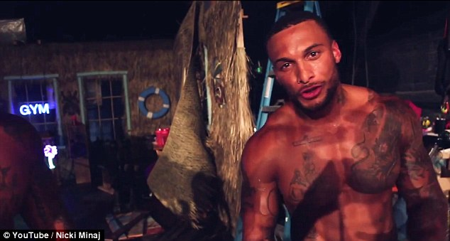 Topless: David McIntosh  appeared ina racy behind-the-scenes look at Nicki Minaj's new video released on Thursday