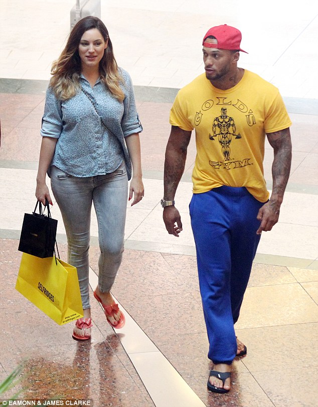 Loved-up: David and Kelly were snapped at Manchester's Trafford Centre on Friday, before grabbing a burger