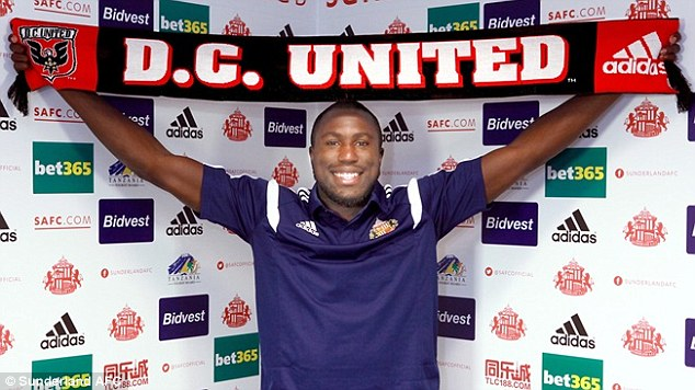 American link: Sunderland's USA international Jozy Altidore holds up a D.C. United scarf