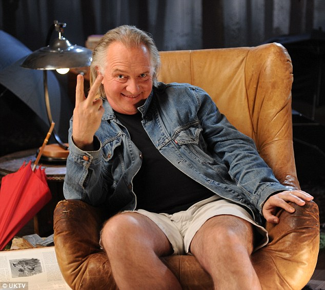 Final farewell: Rik Mayall flashes his signature two-finger salute in the promo shot for Crackanory
