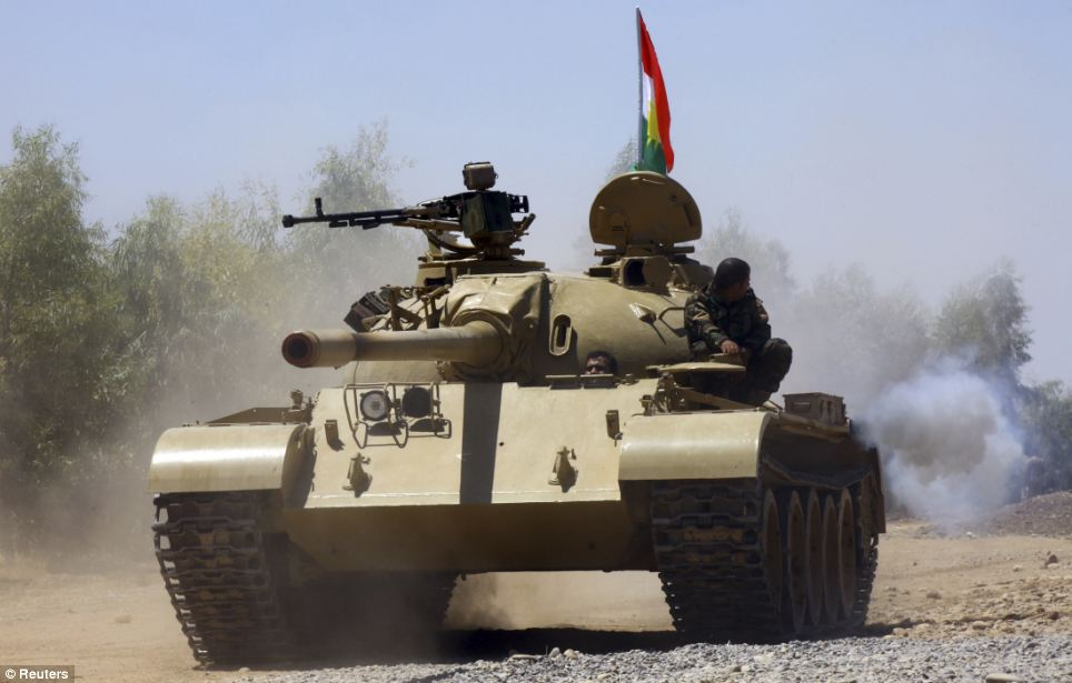 Rolling tanks: Peshmerga fighters are pictured yesterday patrolling their territory in an operation against the ISIS fighters