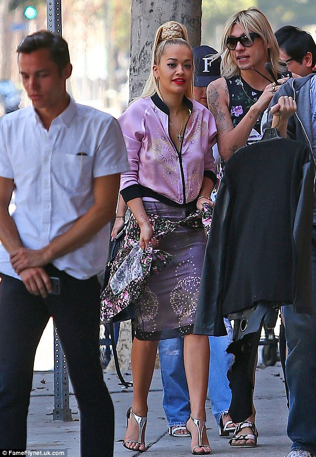 Tough times: Rita Ora tells Glamour magazine that she is not over her split from Calvin Harris