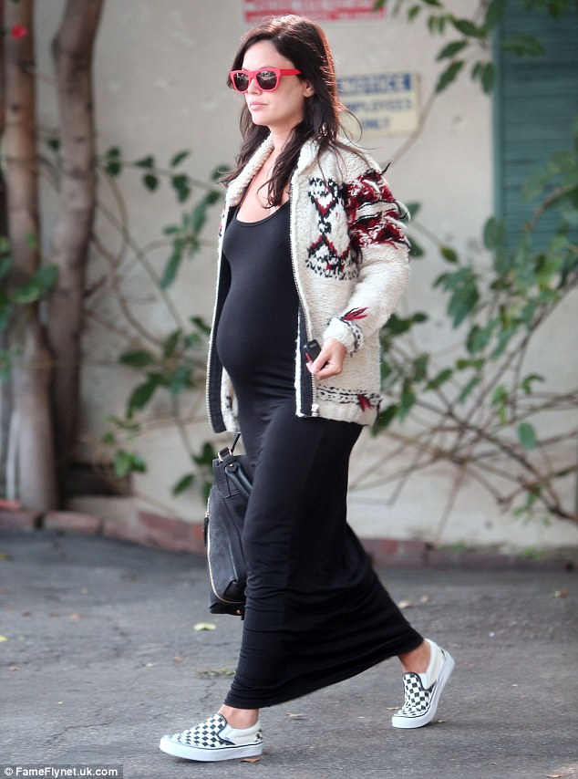 Bumping along nicely! Rachel Bilson highlighted her blossoming baby bump in a clinging black maxi dress as she treated herself to a manicure in Sherman Oaks, Los Angeles on Thursday