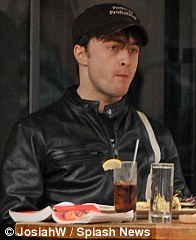Table for one: Daniel Radcliffe with only a book for company, Leanne Rimes enjoying a solo lunch with a cocktail in Santa Monica, California, and Ryan Gosling grabbing a bite to eat alone in NoHo, New York