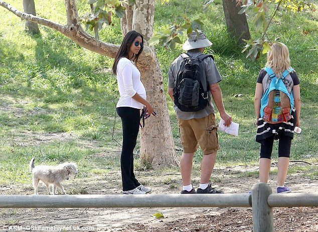 Down to earth: Zoe stopped to chat to some fellow hikers while out with her rescue mutt Mugsy